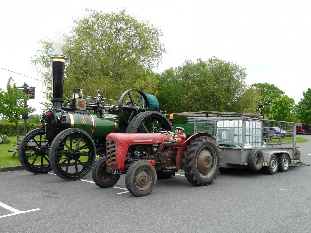 Talking of tractors, Finningan pictured here with Victoria carrying the water cube for Victorias Water supply