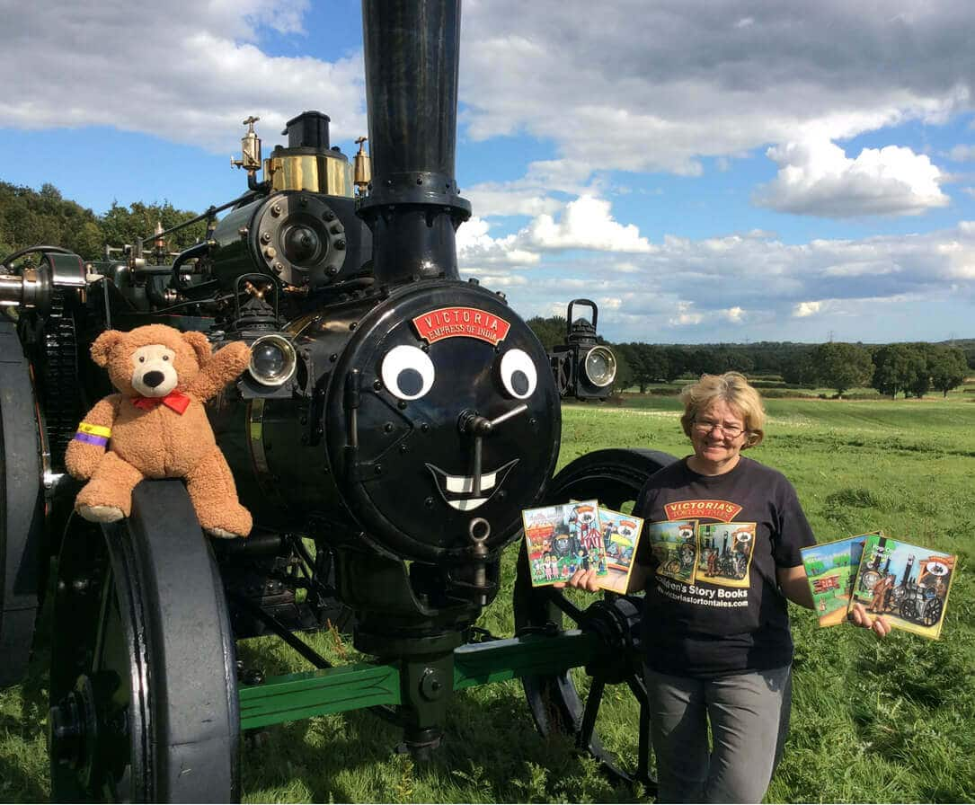 Wendy Wakelin with Victoria the traction engine, her four books and Colin the Teddy Bear